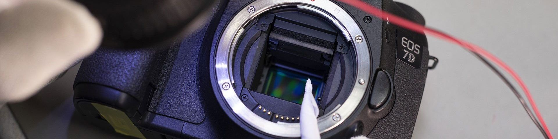A close-up of a Canon EOS 7D body showing the sensor inside